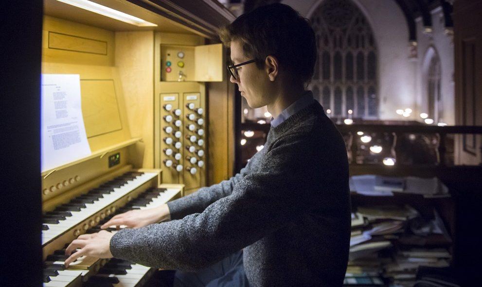 An organist plays music in the Lincoln's Inn Chapel