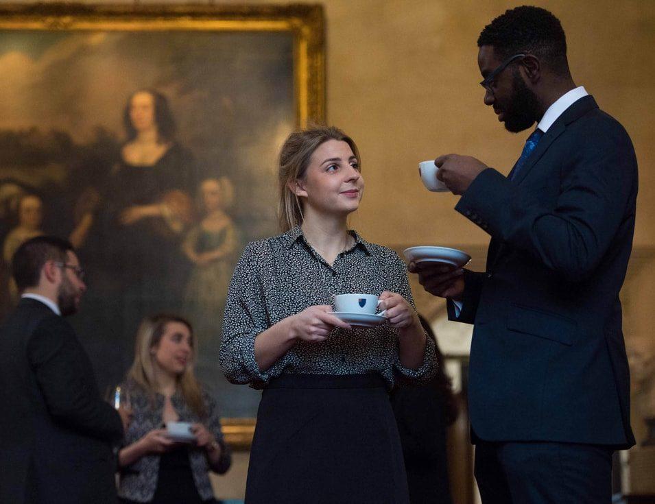 People socialising and having tea