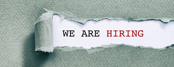 We are hiring written under torn paper.