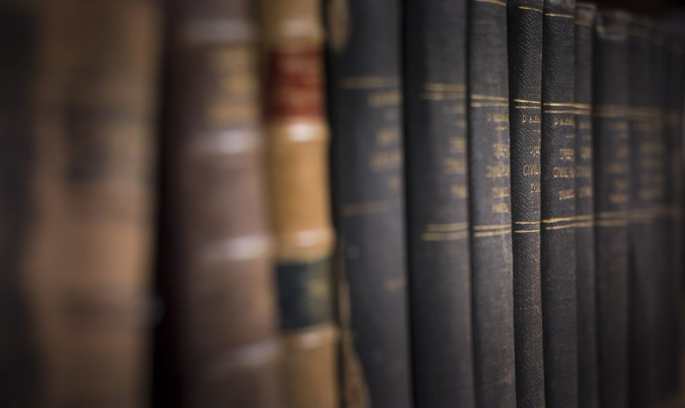 row of legal books on shelf