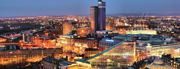 Manchester, EnglanManchester city center skyline at night showing various buildings and streets
